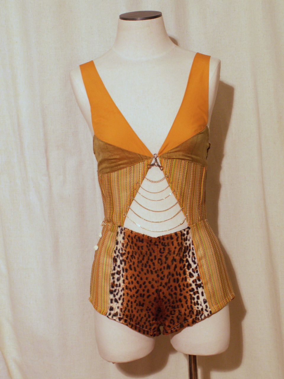 Tiger Onesie- woven plastic, fake fur, cotton fabric, vintage buttons, fireplace chain, various necklace chains, wire, Size medium