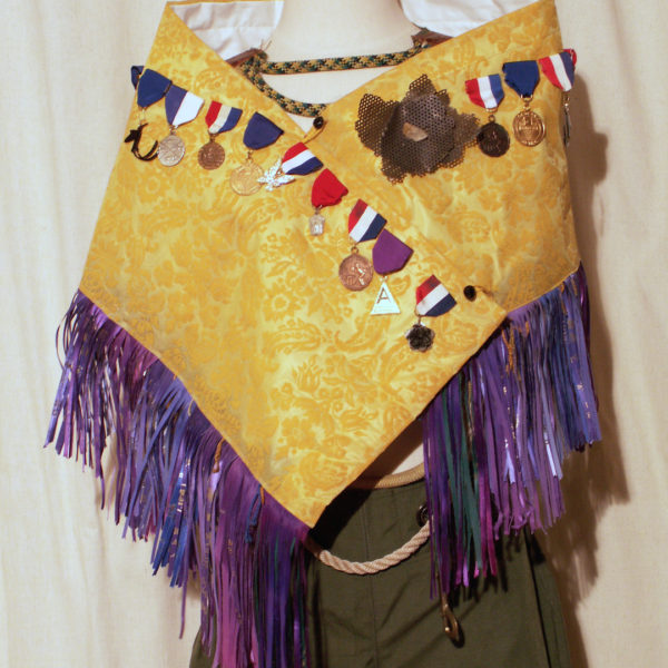 Warrior, Ego Shawl- plastic curtain, first place ribbons, medals, jewelry charms